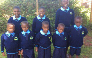 Some of the first students to get their new uniforms, children from the babies home.
