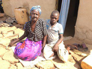 vulnerable-woman-and-grandchild-in-the-slums-Uganda