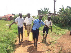 young-boys-helping-family-fetch-clean-water