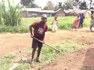 boy-helping-neighbor-maintain-compoud