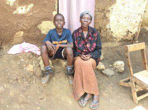 boy-and-mom-in-slum-housing