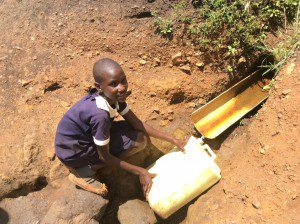 young-girl-helping-community-get-clean-water-Uganda