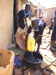 students-fetch-clean-drinking-water-for-woman-in-slums