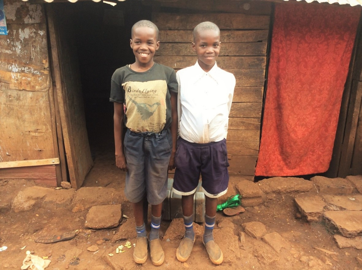 twin-brothers-students-at-free-school-in-slums