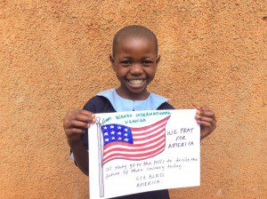 girl-from-uganda-showing-suport-for-american-voters