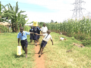 students-on-walk-back-to-campus-delivering-clean-water