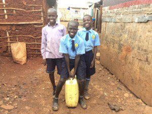 students-in-slum-collecting-clean-water-for-community