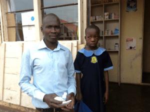 uganda-teacher-helps-little-girl-to-hospital