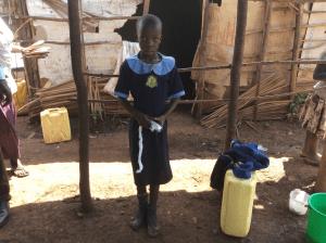 little-girl-in-slums-helped-by-nonprofit-organization
