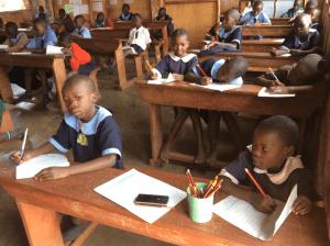 african-girl-testing-at-free-school-in-slums
