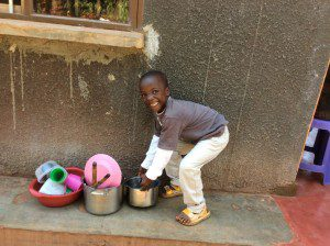 kid-helps-foster-mom-in-uganda-orphanage