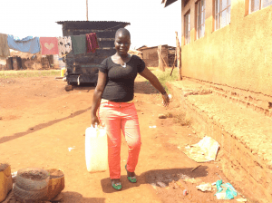 girl-fetching-clean-drinking-water-uganda-outreach