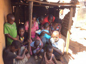 children-praying-with-family-in-slums-uganda