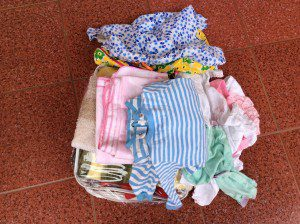 advocate-provides-mother-in-slums-uganda-with-baby-clothes