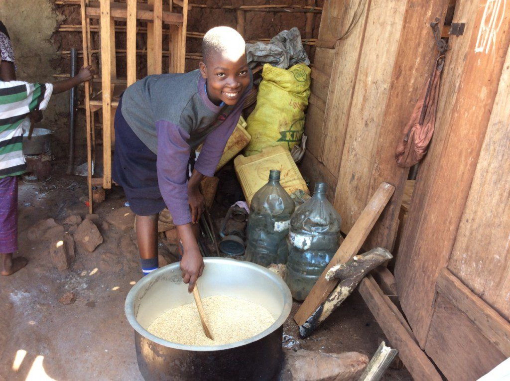 outreach-team-cooking-food-for-vulnerable-family-uganda