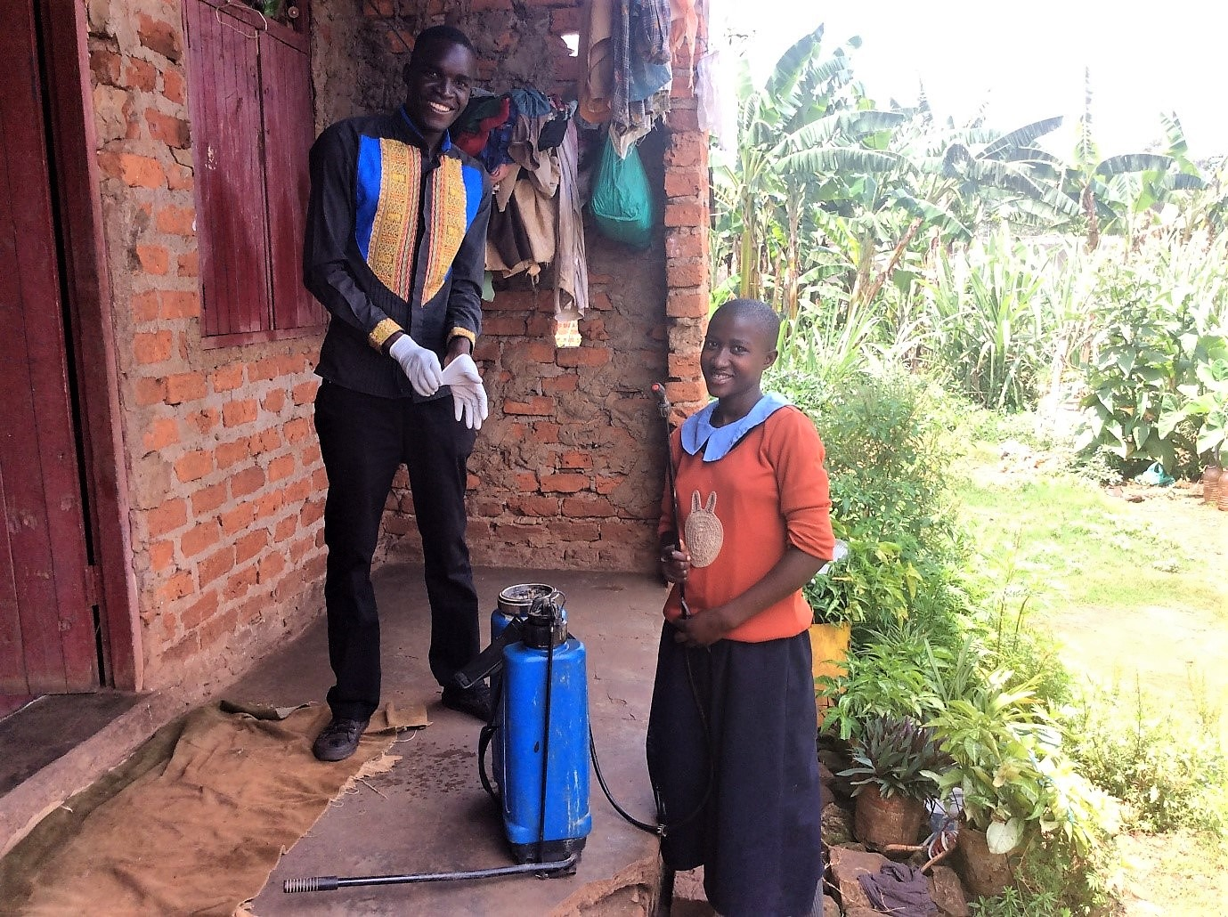 community-outreach-members-helping-family-uganda