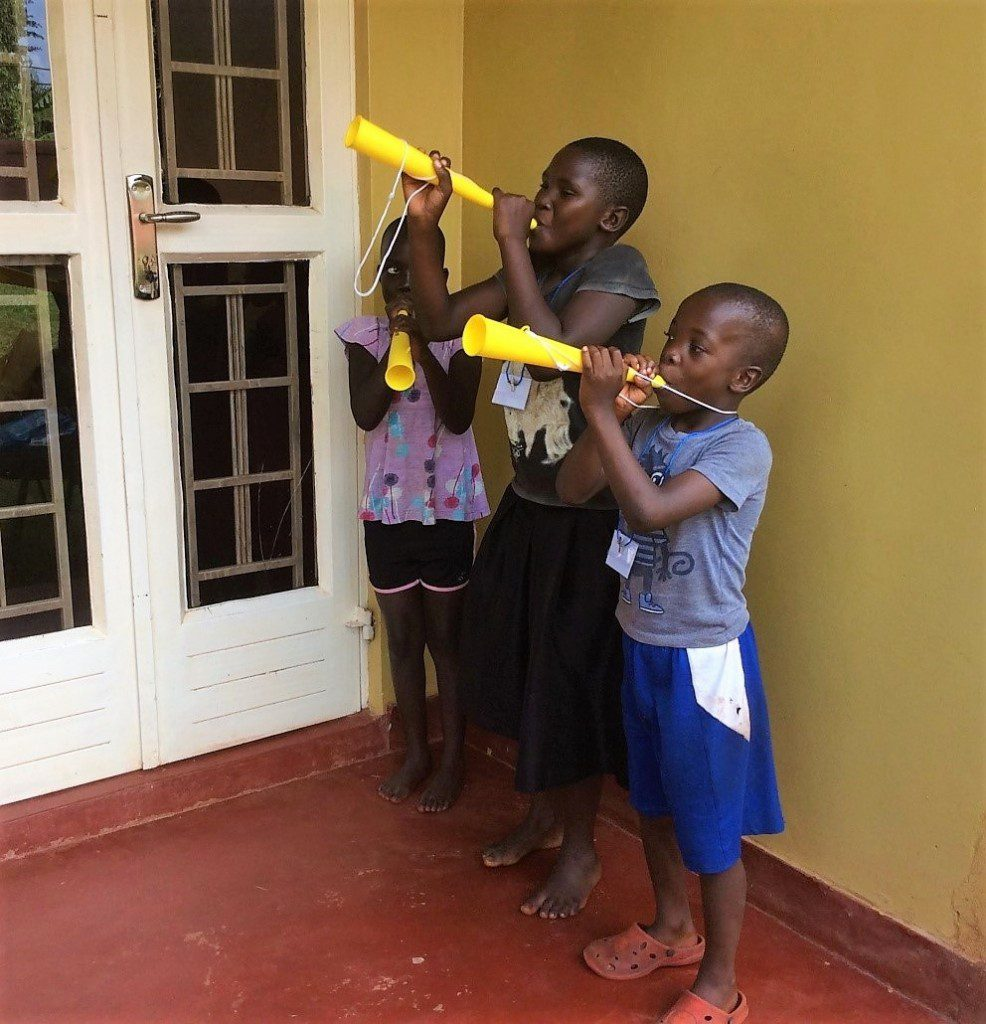orphans-uganda-learn-musical-instruments